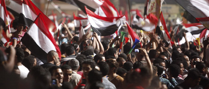 Anti-Morsi protesters wave Egyptian flags in Cairo's Tahrir Square July 3, 2013 (Reuters).