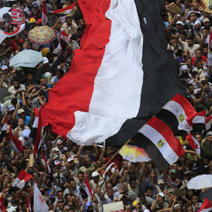 Protesters carry a giant Egyptian flag during a rally in Cairo June 22, 2012. (Reuters)