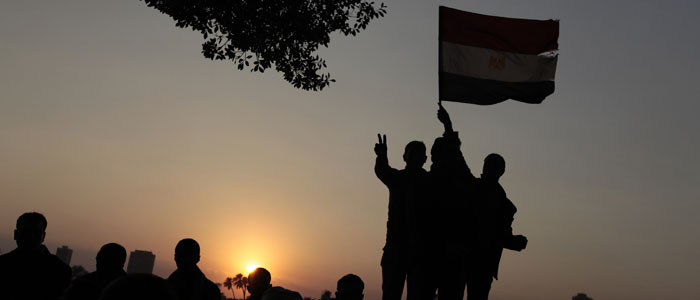 The sun sets on protesters as they demonstrate in Cairo's Tahrir Square February 11, 2011. (Reuters)