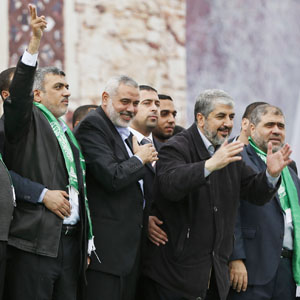 Hamas chief Khaled Mashal (2nd R), with senior Hamas leaders, gestures to the crowd during a rally marking the 25th anniversary of the founding of Hamas, in Gaza City, in this December 8, 2012, file photo. (Reuters)