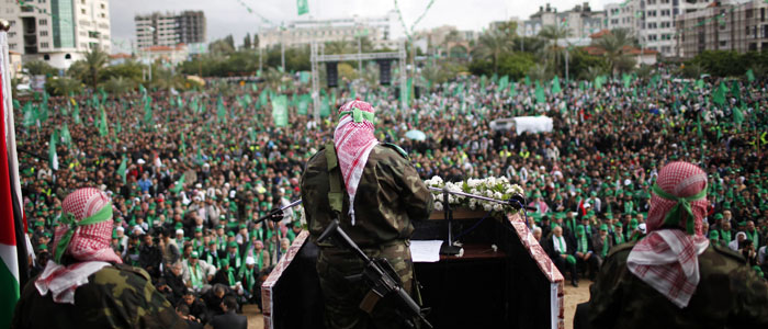 A Palestinian member of the Al-Qassam brigades gives a speech during a rally marking the 25th anniversary of the founding of Hamas, in Gaza City