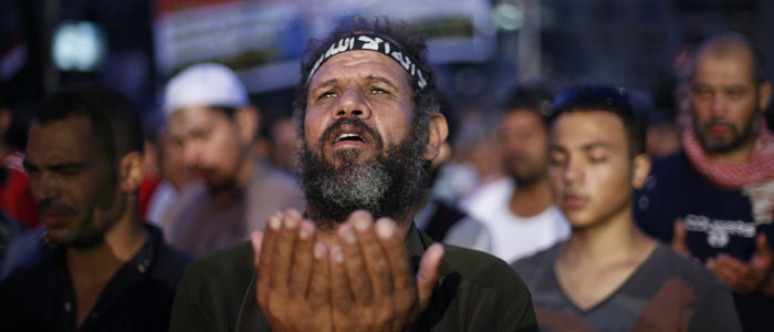 A supporter of deposed Egyptian president Mohamed Morsi prays during a rally in Cairo July 8, 2013. (Reuters