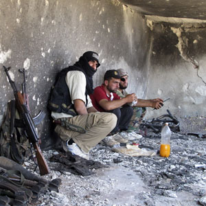Free Syrian Army fighters take positions during what they say is an offensive against government forces, in Idlib July 17, 2013. (Reuters)