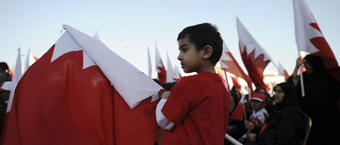 A boy carries a Bahraini flag at a pro-government rally in Muharraq, north of Manama, Bahrain's capital, February 21, 2013. (Reuters)