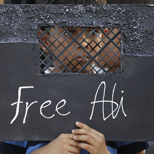 "A boy holds a placard representing a prison cell, reading ""Free Ali,"" during a protest in the village of Sadad, south of Manama June 10, 2012. Protesters were calling for the release of Ali Hassan, a 12-year-old who authorities said was detained for participating in an illegal gathering and burning tires. (Reuters)"