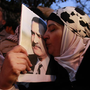 A woman kisses a picture of late Egyptian president Gamal Abdel Nasser during a rally in Amman, Jordan, February 1, 2011. (Reuters)