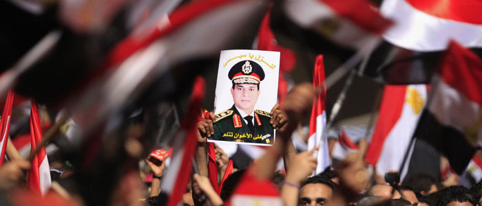 Anti-Morsi protesters hold a poster depicting the head of Egypt's armed forces, General Abdel Fattah al-Sisi, in Cairo's Tahrir Square July 3, 2013. (Reuters)