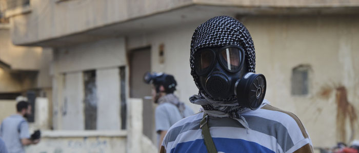 An activist wearing a gas mask is seen in an eastern Damascus suburb where Syrian government forces allegedly used chemical weapons, August 22, 2013. (Reuters)