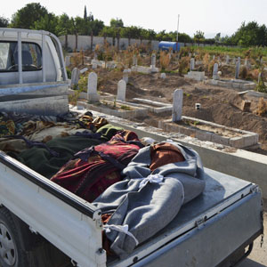 The bodies of victims of what activists say was a chemical attack are seen laid out on a truck at a cemetery in the Hamoria area, in the eastern suburbs of Damascus, August 21, 2013. (Reuters)