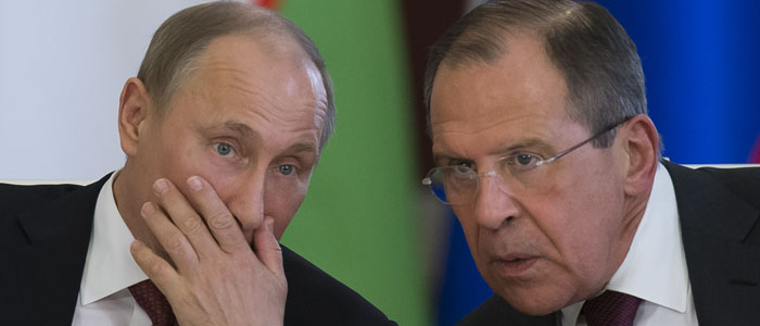 Russian President Vladimir Putin confers with Foreign Minister Sergei Lavrov (AP file photo).