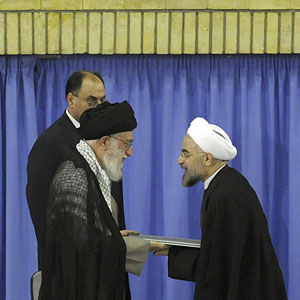 Iran's Supreme Leader Ayatollah Ali Khamenei (L) gives his official seal of approval to then President-elect Hassan Rouhani, in an official endorsement ceremony in Tehran, Iran, August 3, 2013. (AP)