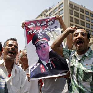 Supporters of the interim government installed by the army cheer Egypt's army chief, General Abdel Fattah al-Sisi (pictured on poster), and shout slogans against the Muslim Brotherhood in front of al-Fath mosque in Cairo's Ramses Square August 17, 2013. (Reuters)