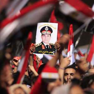 Anti-Morsi protesters hold up a poster featuring the head of Egypt's armed forces, General Abdel Fattah al-Sisi, in Cairo's Tahrir Square July 3, 2013. (Reuters)