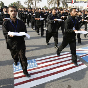 Shi'ite worshipers step on U.S. and British flags painted on a street during a parade in Basra in this November 14, 2007, file photo (Reuters).