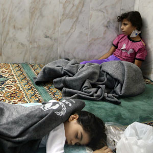 Girls who purportedly survived a chemical attack rest inside a mosque in the Duma neighborhood of Damascus August 21, 2013.