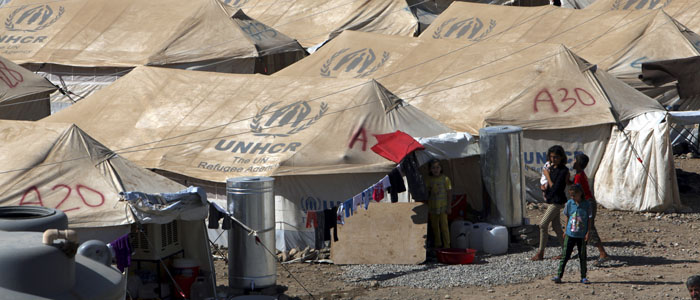 Syrians, who fled the violence in their home country, walk at a new refugee camp near Arbil in Iraq's Kurdistan region August 26, 2013. (Reuters)