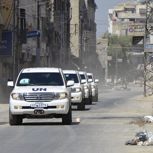 A convoy of U.N. vehicles carrying a team of United Nations chemical weapons experts is seen driving through one of the chemical weapons attack areas in the eastern Damascus suburb of Ghouta August 28, 2013. (Reuters)