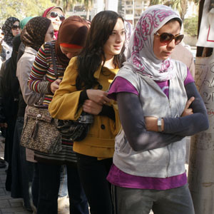 Women queue to vote in a referendum on Egypt's constitution at a polling station in Alexandria, in this December 15, 2012, file photo. (Reuters)