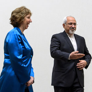 Iranian Foreign Minister Mohammad Javad Zarif (R) gestures next to European Union foreign policy chief Catherine Ashton during a photo opportunity before the start of nuclear talks at U.N. offices in Geneva October 15, 2013. (Reuters)