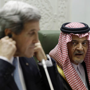 U.S. Secretary of State John Kerry adjusts his translation headset as Saudi Foreign Minister Prince Saud al-Faisal speaks during a news conference in Riyadh March 4, 2013. (Reuters)