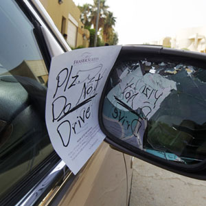 "A ""Please don't drive"" note purportedly anonymously placed on a car of a female driver is seen in Saudi Arabia (Reuters file)."