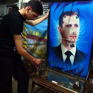 A youth plays with a game made from remnants of mortar shells and decorated with a defaced picture of Syria's President Bashar al-Assad in a basement in the Duma neighborhood of Damascus October 16, 2013. (Reuters)