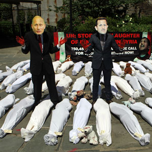 Protesters with masks depicting the faces of Russian President Vladimir Putin (L) and Syrian President Bashar al-Assad pose surrounded by fake corpses outside U.N. headquarters in New York June 7, 2012. (Reuters)