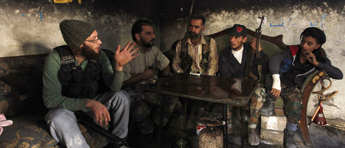 Free Syrian Army fighters are seen strategizing in Aleppo (Reuters file).