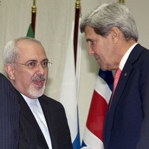 U.S. Secretary of State John Kerry (R) chats with Iranian Foreign Minister Mohammad Javad Zarif at the United Nations Palais in Geneva November 24, 2013. (Reuters)