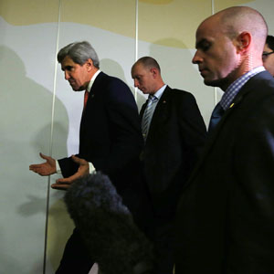 U.S. Secretary of State John Kerry (L) gestures as he leaves a news conference held at the end of the Iranian nuclear talks in Geneva November 10, 2013. (Reuters)