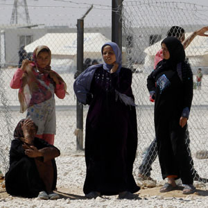 FILE - A group of Syrian women refugees are seen at the Za'atri refugee camp in Jordan. (Reuters)