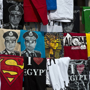 Shirts, some depicting Major General Abdel Fattah al-Sissi, are displayed for sale on Cairo's Tahrir Square October 6, 2013. (AFP)