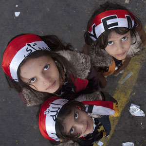 Girls wear headbands in the colors of the Yemeni national flag while standing at a rally in Change Square in Sana'a January 2, 2012. (Reuters)