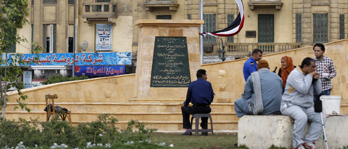 People are seen at a memorial to victims killed during protests in Egypt since the January 2011 revolution, in Cairo's Tahrir Square December 5, 2013. (Reuters)