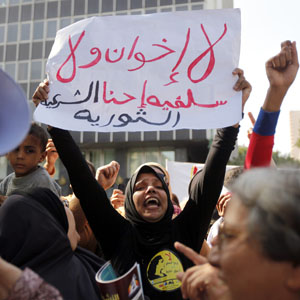 Protesters shout slogans at a women's rights rally in Cairo November 13, 2013. (Reuters)