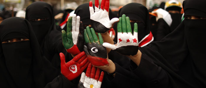 FILE - Female protesters display their hands, painted with the colors of the flags of Yemen, Egypt, Tunisia and Syria, during a rally in Sana'a, Yemen. (Reuters)