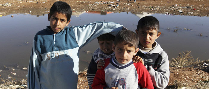 Syrian refugee children pose near their camp in Amman, Jordan, December 23, 2013. (Reuters)
