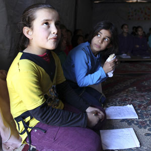 Syrian refugee children attend a class at their camp in Amman December 23, 2013. (Reuters)