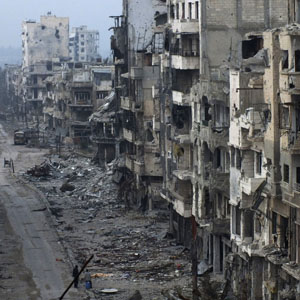 Damaged buildings are seen in a bombed area of Homs Jan. 27, 2014. (Reuters)